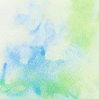 Abstract colorful watercolor background painted on grainy paper
