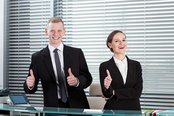 Receptionists showing thumbs up sign