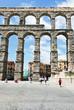 tourist near Aqueduct of Segovia, Spain