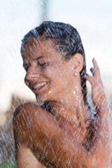 woman in tropical shower