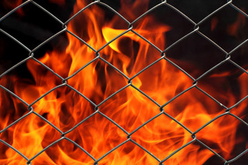 Metal net with flames burning