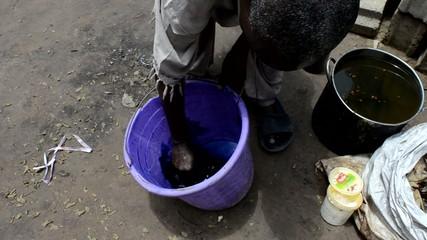African man prepares natural dye for fabrics
