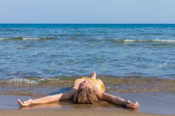 young woman relaxing on the beach