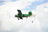 parachuting jump from small green aircraft poster