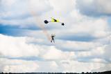 man landing after parachuting jump poster