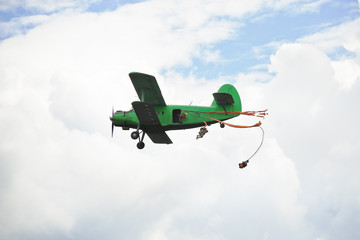 parachuting jump from small green aircraft