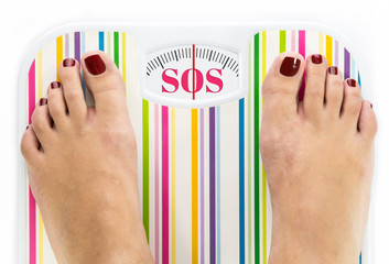 "Feet on bathroom scale with word ""SOS"" on dial"