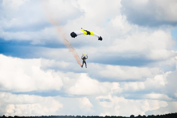 man landing after parachuting jump