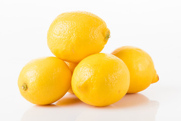 Ripe lemons isolated on white.