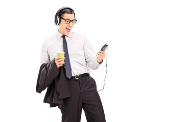 Young man listening to his favorite songs on phone