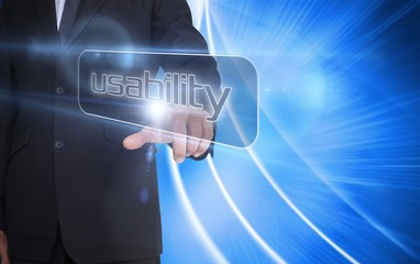 Businessman pointing to word usability