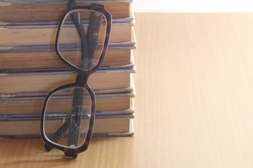 a pile of books and glasses