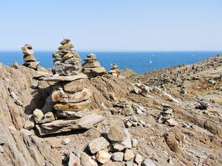 stone pyramids on Cap de Creus natural park, Spain