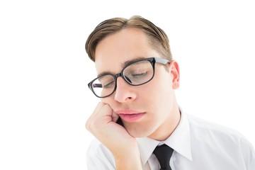 Geeky hipster falling asleep on hand