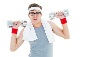 Geeky hipster lifting heavy dumbbells