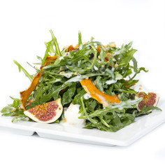 salad of arugula figs and cheese on white background