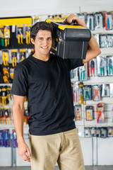 Handsome Man Carrying Toolbox On Shoulder In Store