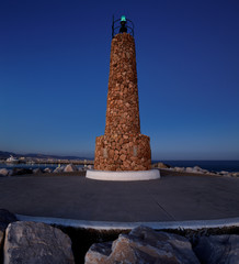 Lighthouse at the breakwater in Puerto Banus, Marbella, Spain