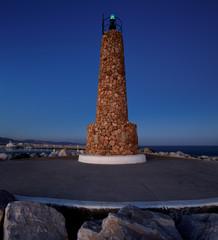 Lighthouse at the breakwater in Puerto Banus, Marbella, Spain