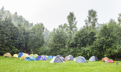 Tents in camping site in the rain.