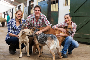 group of farm workers with dogs