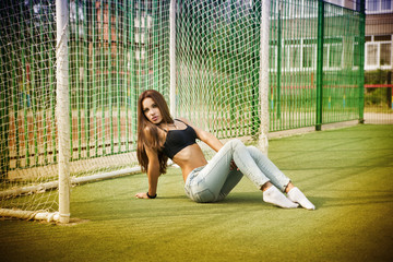 Beautiful young woman on the football field