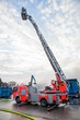 Leinwanddruck Bild - Fire truck with a cherry picker or elevated cage