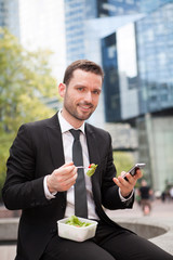 Businessman eating salad for lunch break