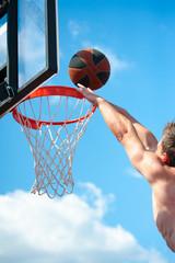 Basketball player throws a ball