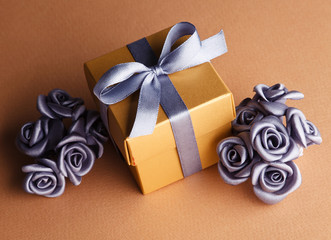 grey flowers and golden gift box