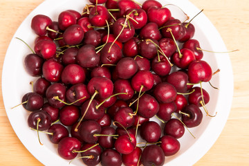 White Plate of Fresh Red Cherries