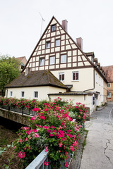 Bavarian house and bridge decorated with flowers