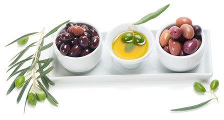 Assorted pitted olives with olive oil in a ceramic bowls