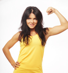 young sporty woman flexing her biceps