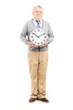 Senior gentleman holding a big wall clock