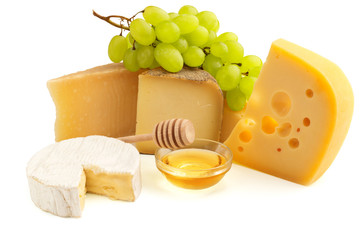 assorted cheese, grape bunch and honey