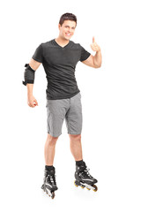 Man on roller skates giving a thumb up