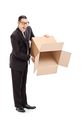 Businessman holding an empty box