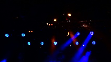 On the stage lights.