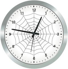 Simple metal analogue clock with spider web