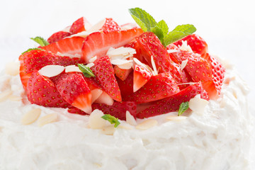 delicious cake with whipped cream and strawberries, close-up