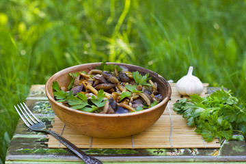 Pickled mushrooms with garlic and parsley outdoor
