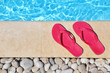 Flip flops by the poolside with water and copy-space - 68115674