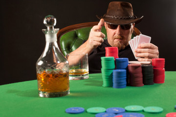Poker player wearing sunglasses and hat