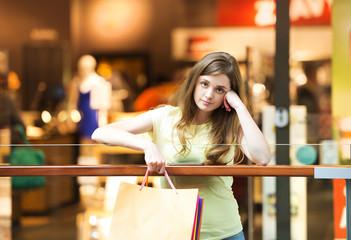 Tired girl in shopping centre