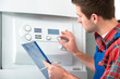Technician servicing heating boiler - 68115846