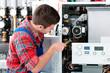 Leinwanddruck Bild - Technician servicing heating boiler
