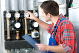 Technician servicing heating boiler poster