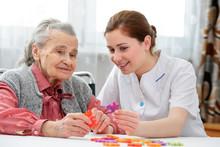 "Постер, картина, фотообои ""Senior woman with her elder care nurse"""