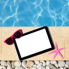 Tablet template by poolside with sunglasses and starfish